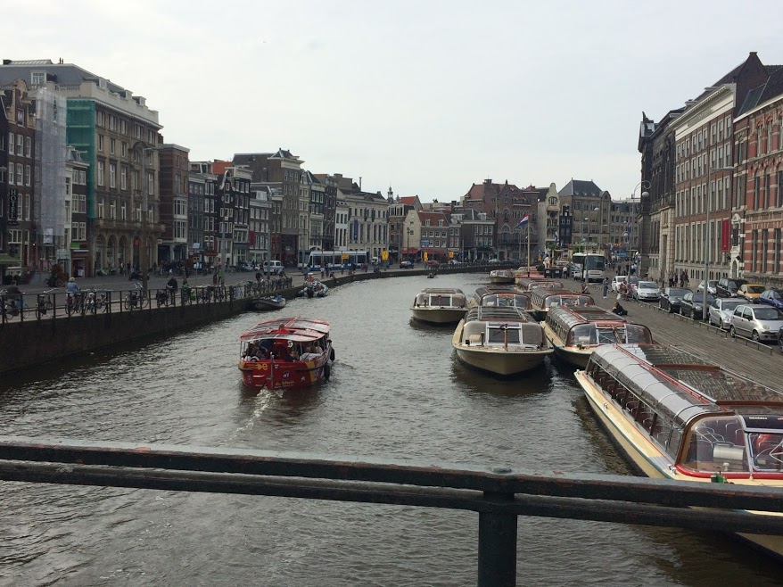Boats in the canal in Amsterdam