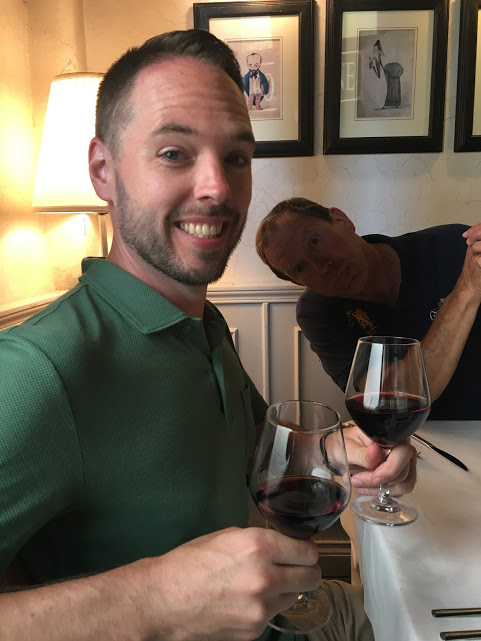 Rick having wine in Florence