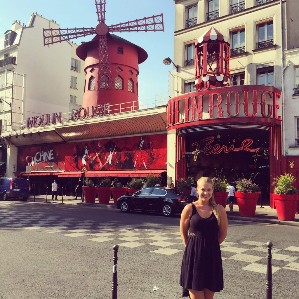 Woman in front of Moulin Rouge