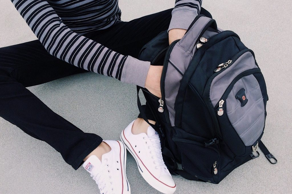 Girl packing a backpack