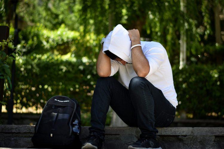 Upset man sitting on a bench